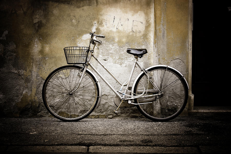 White Bicycle Leaning Aginst Cement Photograph by Moreiso
