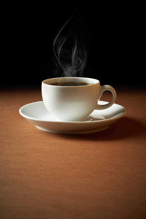 White Cup Of Coffee Sends Up Steam Photograph by Hdere