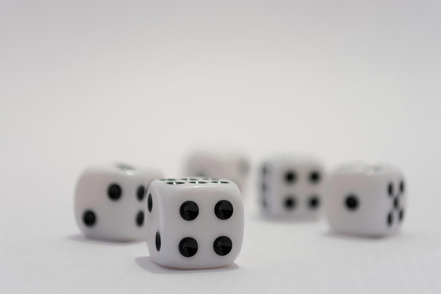 White dice with black dots on white background by Scott Lyons