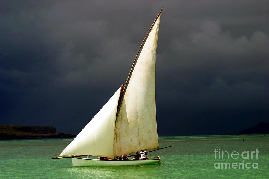 Sailboat Photograph - White Sailed Pirogue On The Ocean by Paul Banton
