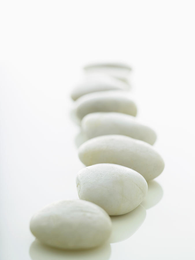 White Stones Lined Up On A White Photograph by Rick Lew