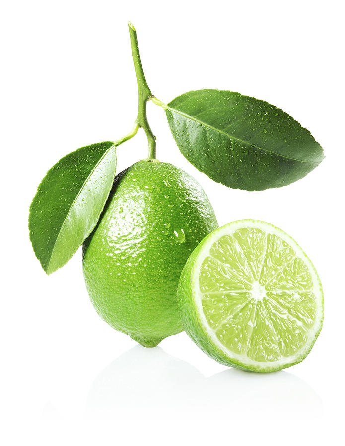 Whole And Half Lime With Leaves Photograph by Lauren Burke