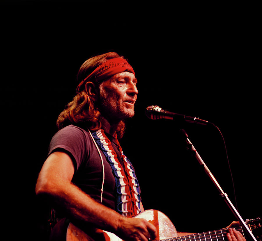 Willie Nelson Performs On Stage Photograph by David Redfern