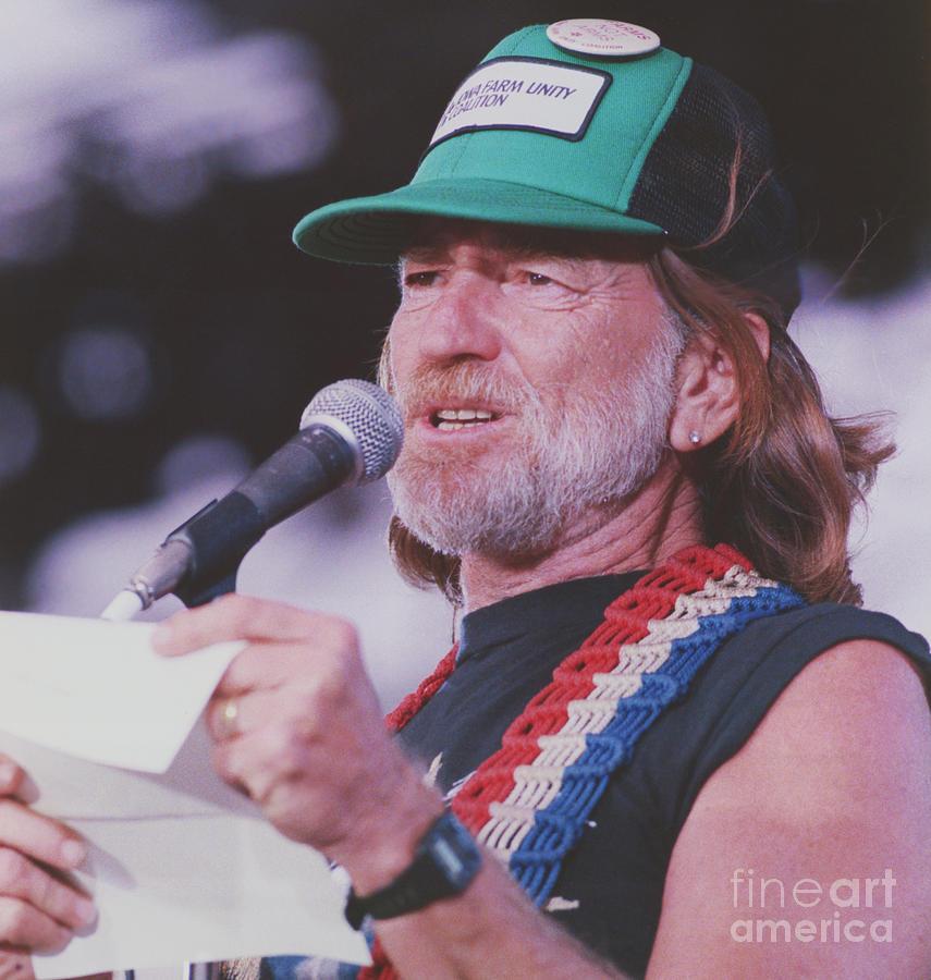 Willie Nelson Reading Letter Photograph by Bettmann