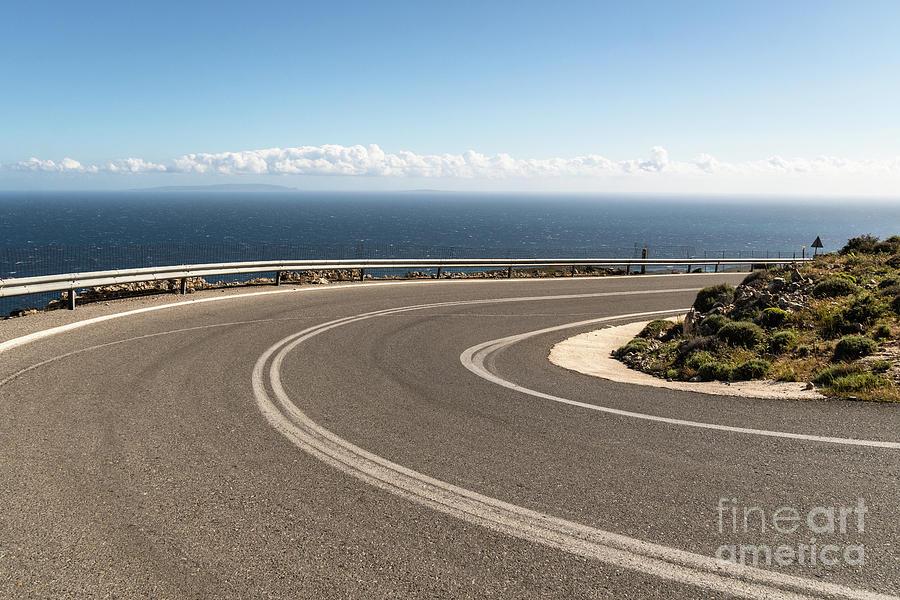 Winding road in Crete, Greece by Didier Marti