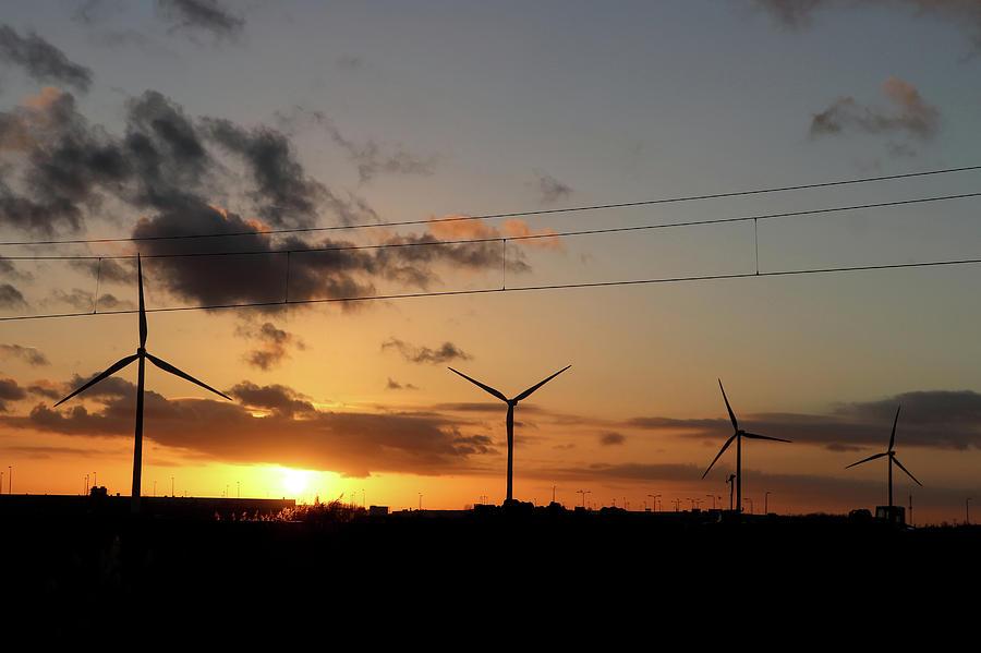 Windmill sunset by Mariella Wassing