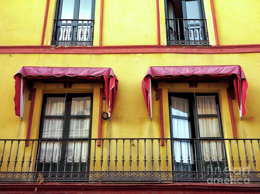 Window Couple in Seville by John Rizzuto