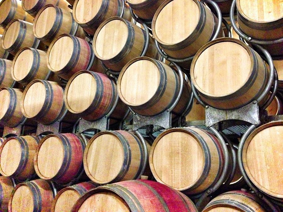 Wine Barrels In Cellar Photograph by Hide