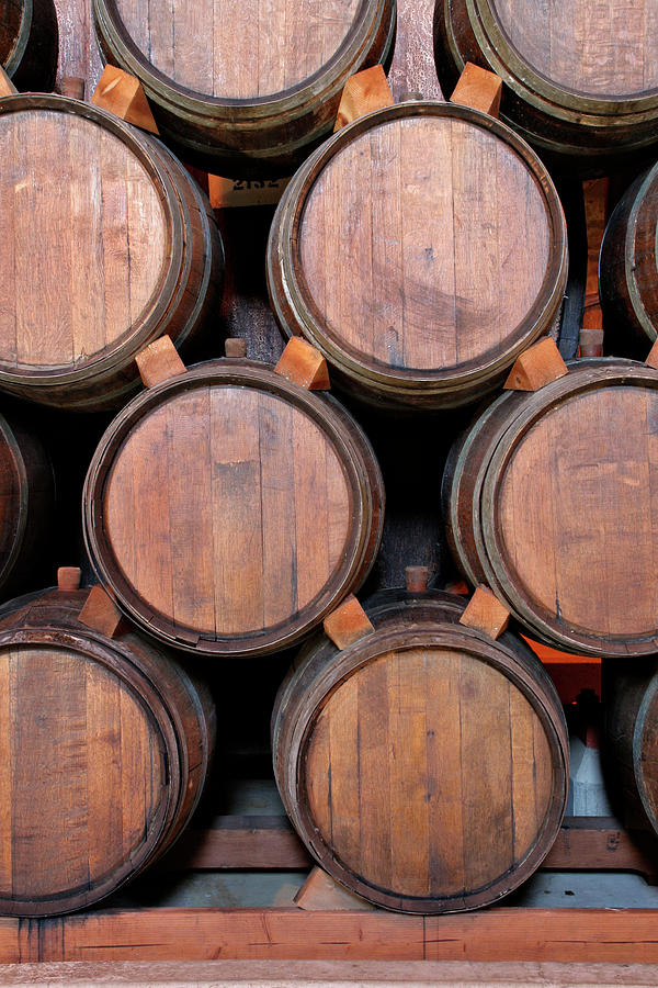 Wine Barrels Stacked Inside Winery Photograph by Yinyang