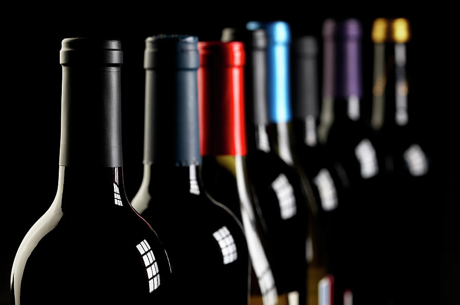 Wine Bottles In A Row On Black Photograph by Hirkophoto