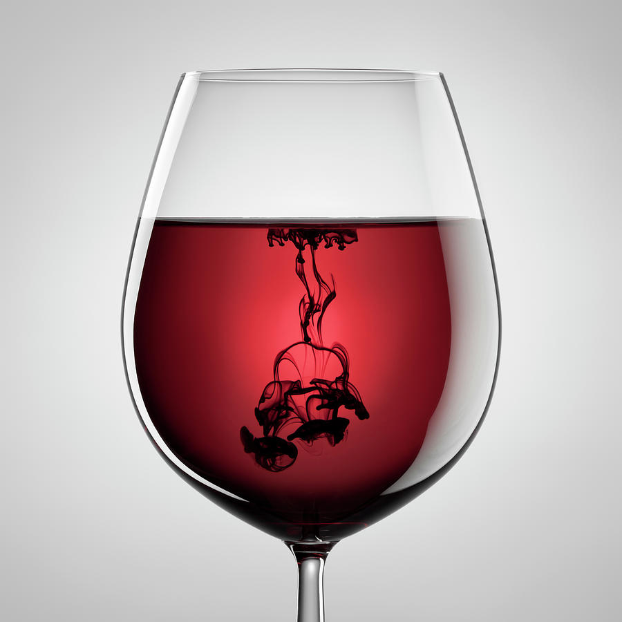 Wineglass, Red Wine And Black Ink Photograph by Thomasvogel