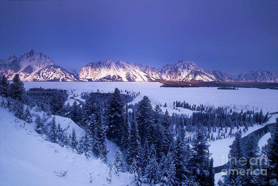 winter sunrise storm grand tetons national park by Dave Welling