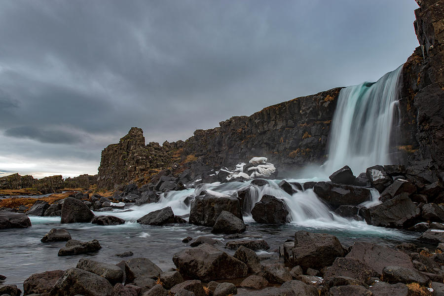 Wintertime in Iceland's waterfall by Dubi Roman