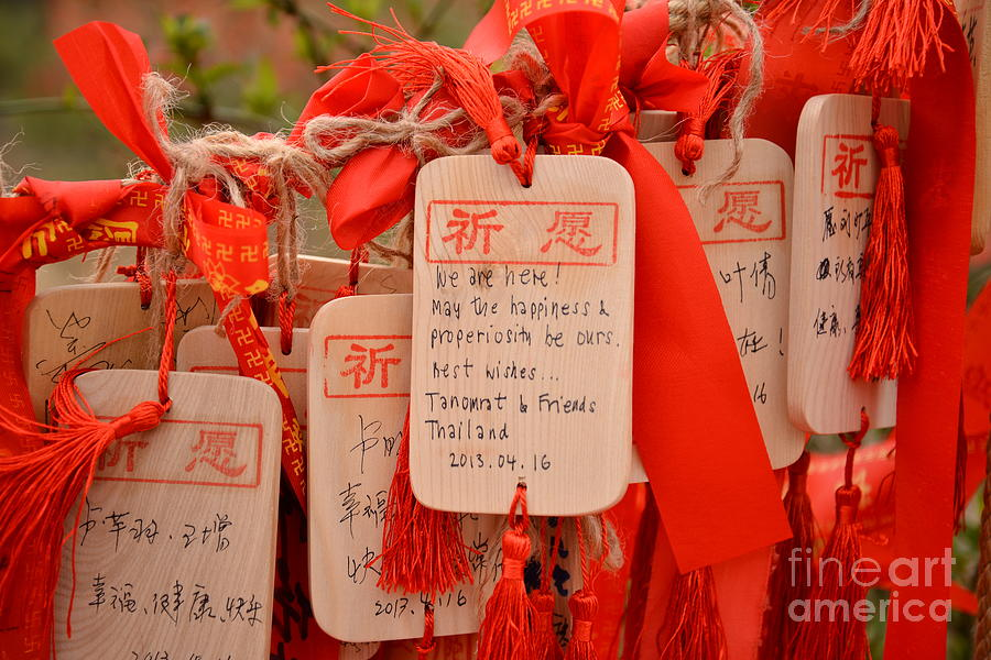 Religious Photograph - Wish Cards In A Buddhist Temple In by Praphat Rattanayanon