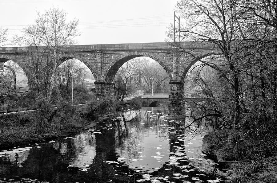 Black And White Photograph - Wissahickon Creek - Reading Viaduct In Black And White by Bill Cannon