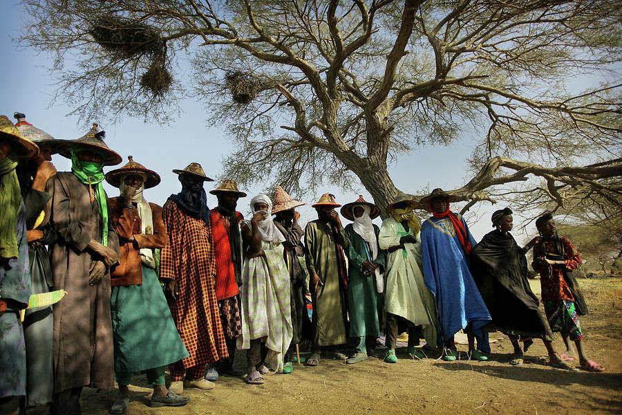 Wodaabe Men Standing Under A Desert Tree Photograph by Timothy Allen