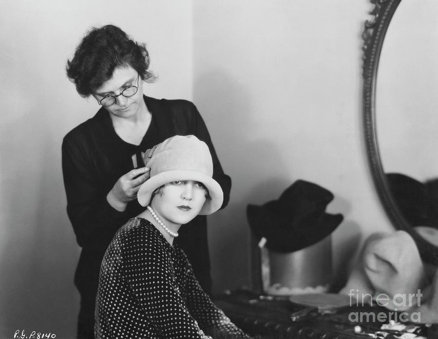 Woman Adjusting Actress Hat Photograph by Bettmann