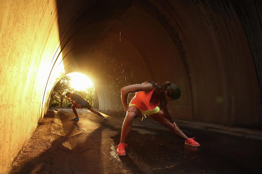 Woman And Man Stretching In Tunnel At Photograph by Stanislaw Pytel
