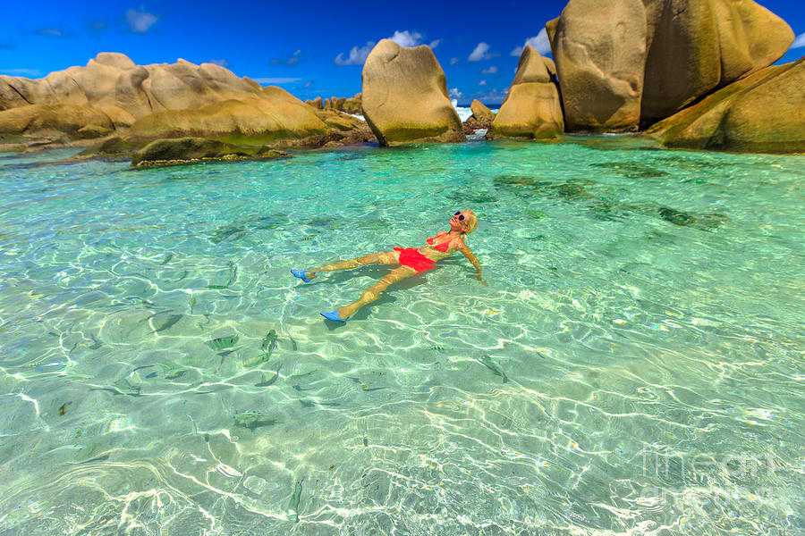Woman at Anse Marron pool by Benny Marty
