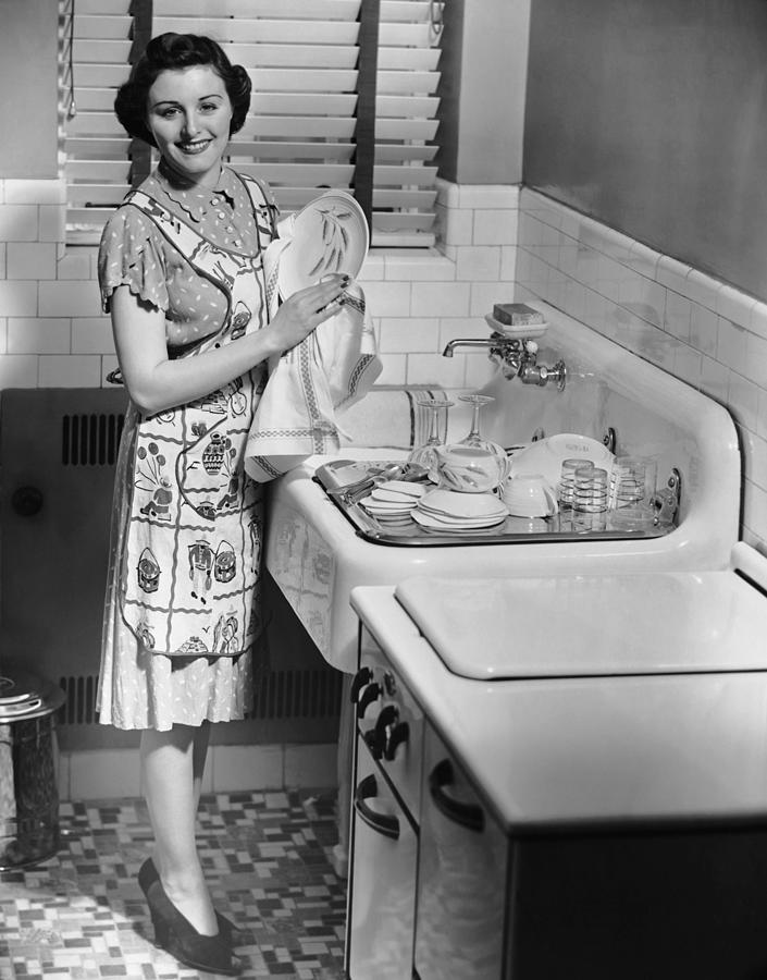 Woman At Sink Washing Dishes Photograph by George Marks