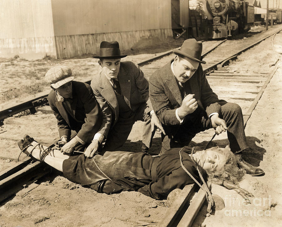 Woman Being Tied To Railroad Tracks Photograph by Bettmann