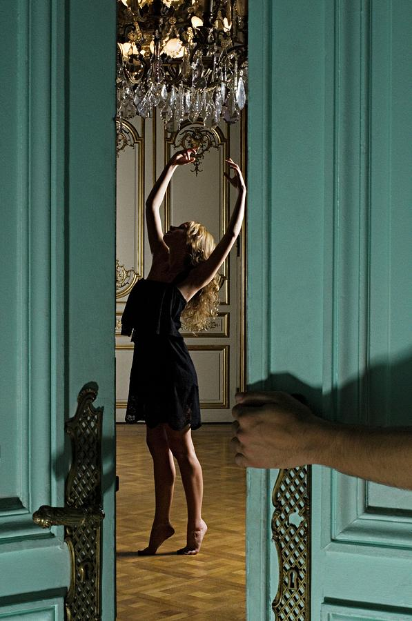 Woman Dancing Beneath Chandelier Photograph by Image Source