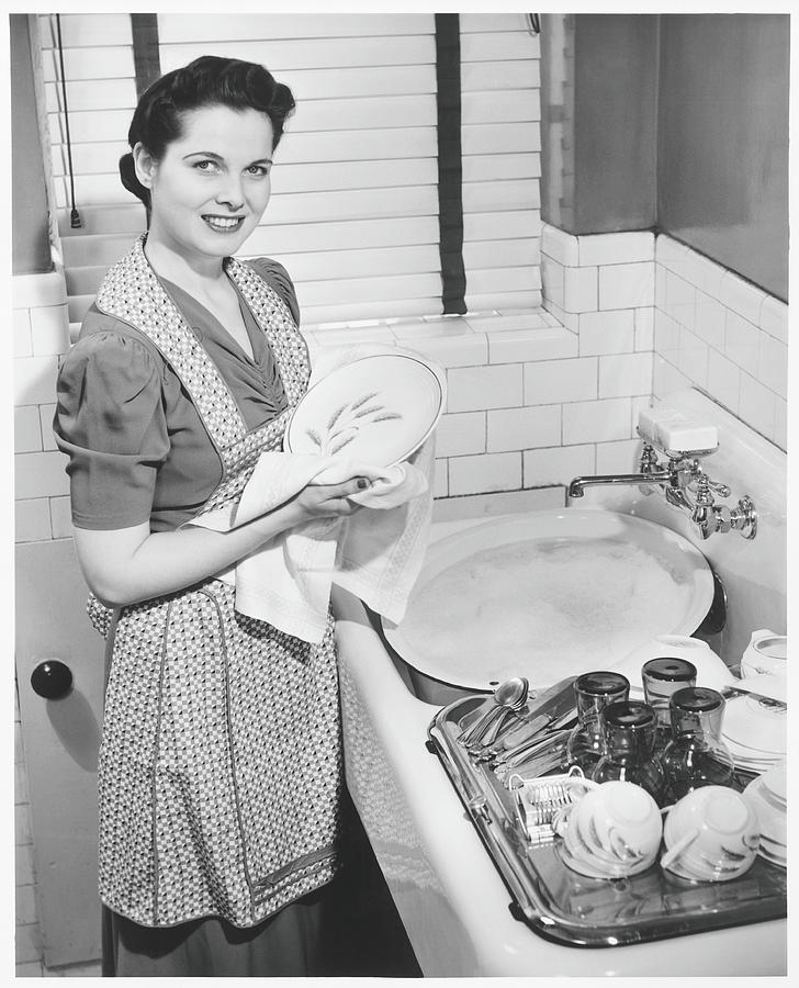 Woman Drying Dishes At Kitchen Sink Photograph by George Marks