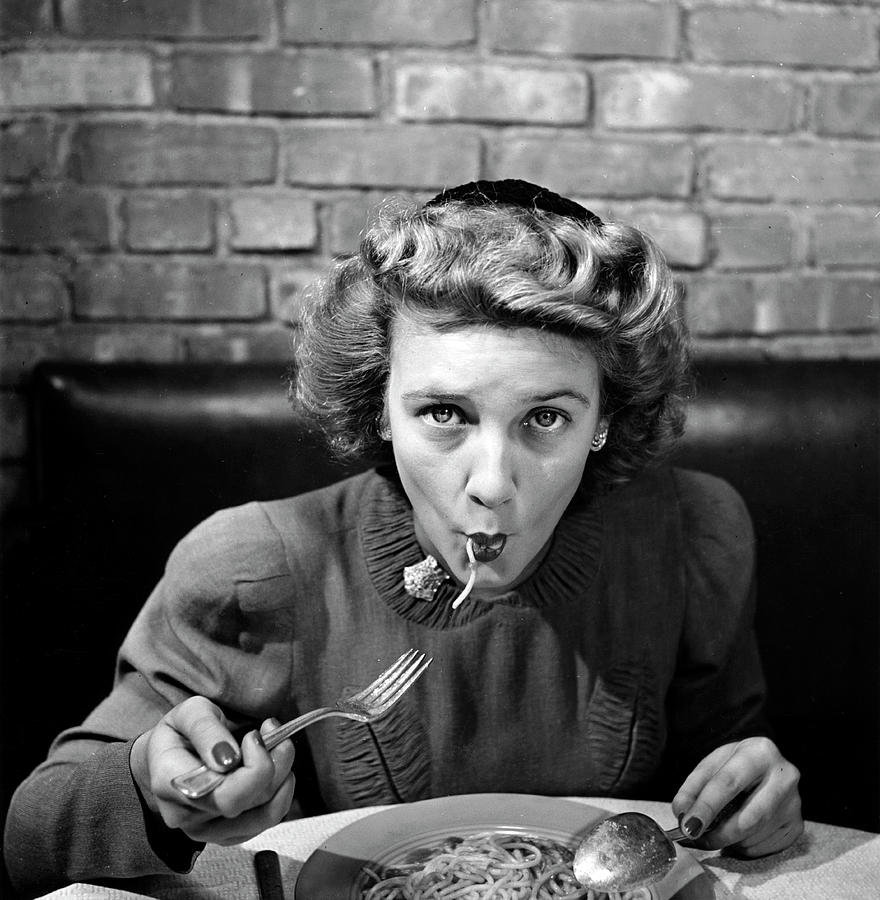 Woman Eating Spaghetti In Restaurant 5 Photograph by Alfred Eisenstaedt