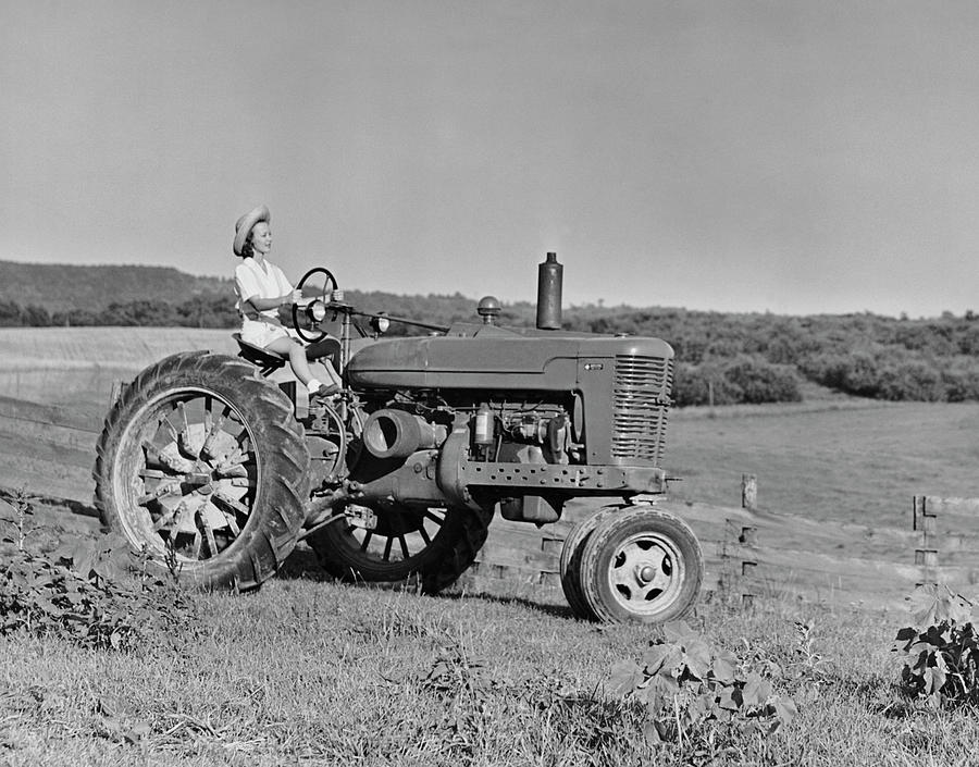 Woman Farmer Driving Tractor Photograph by George Marks