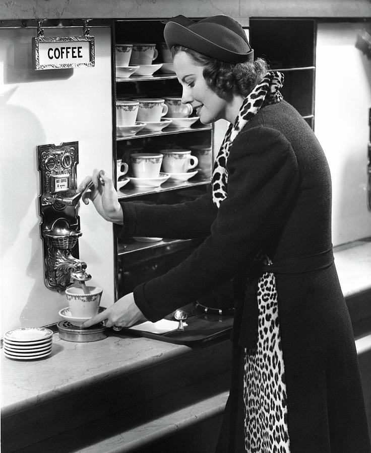 Woman Getting Coffee At Old Fashioned Photograph by George Marks