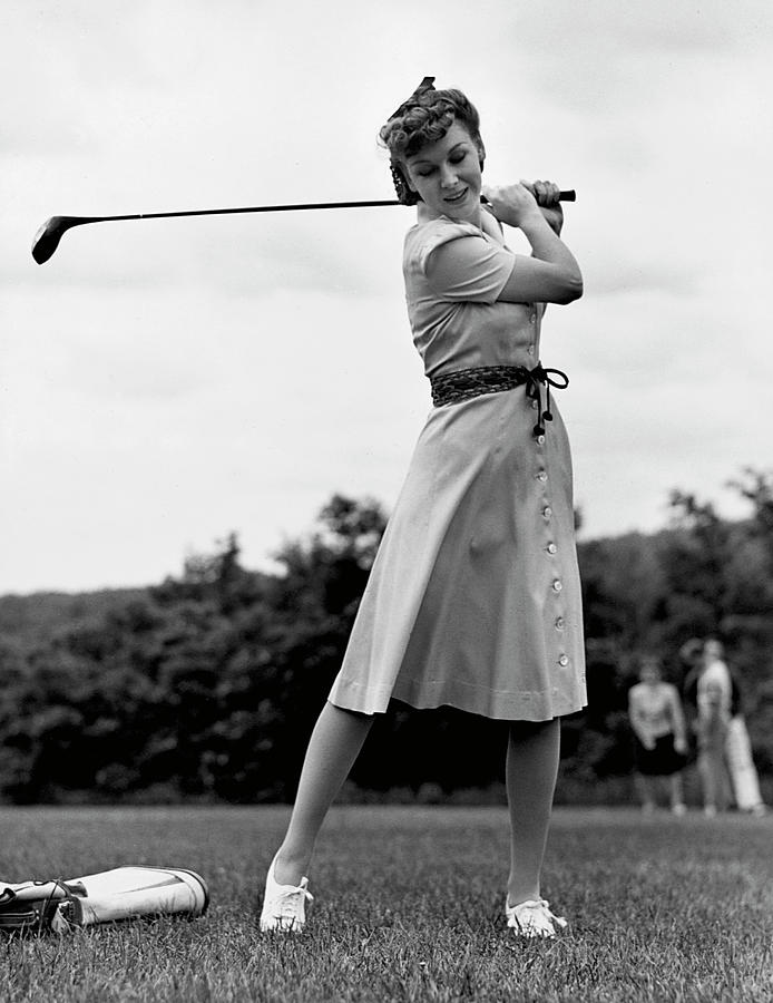 Woman Golfing Photograph by George Marks