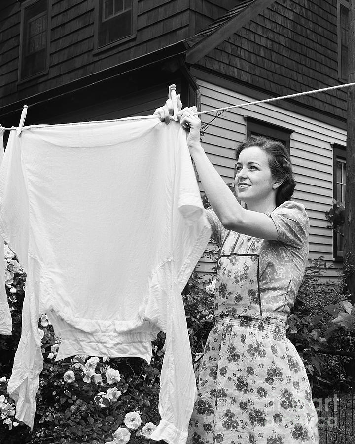 Woman Hanging Laundry Out To Dry Photograph by Bettmann