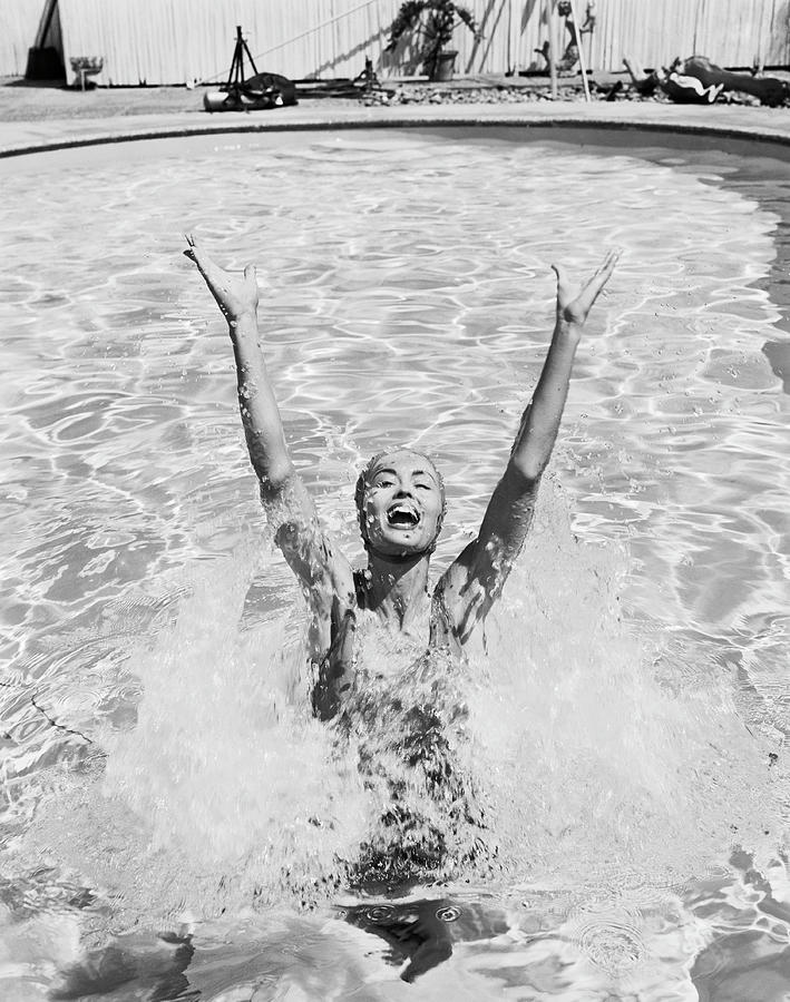 Woman Having Fun In Swimming Pool Photograph by Tom Kelley Archive