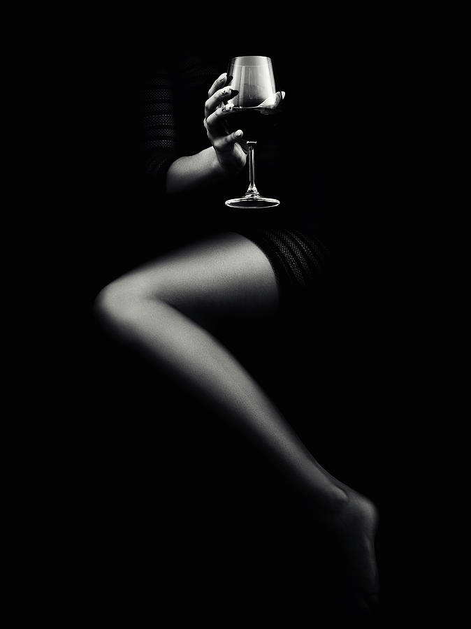 Woman holding red wine by Johan Swanepoel