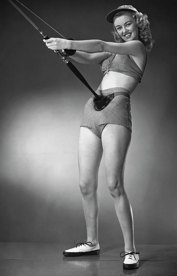 Woman In Beachwear Holding Fishing Rod Photograph by George Marks
