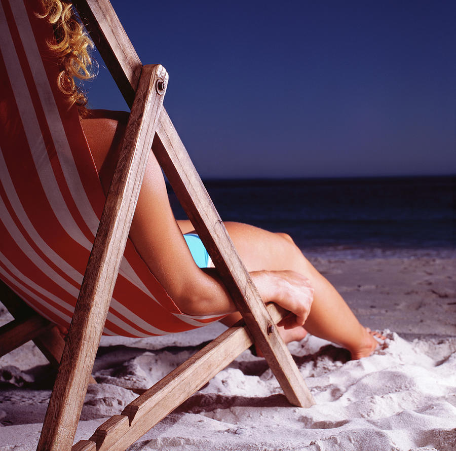 Woman In Deck Chair On Beach, Close Up Photograph by Kelvin Murray