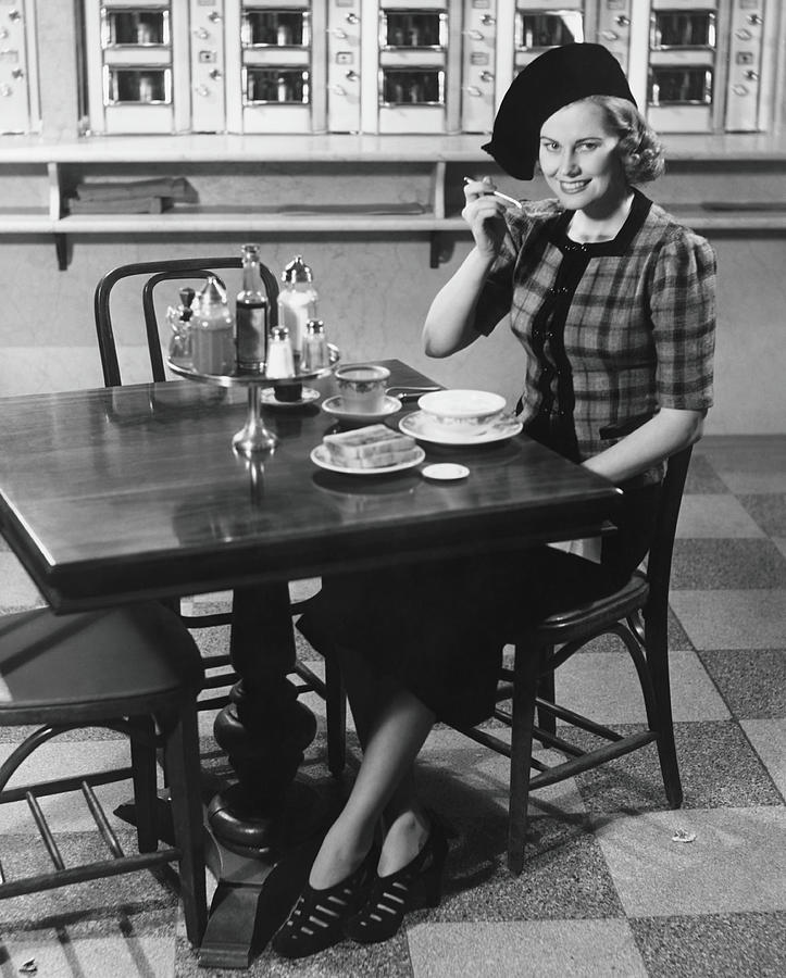 Woman In Fancy Hat Eating Breakfast In Photograph by George Marks