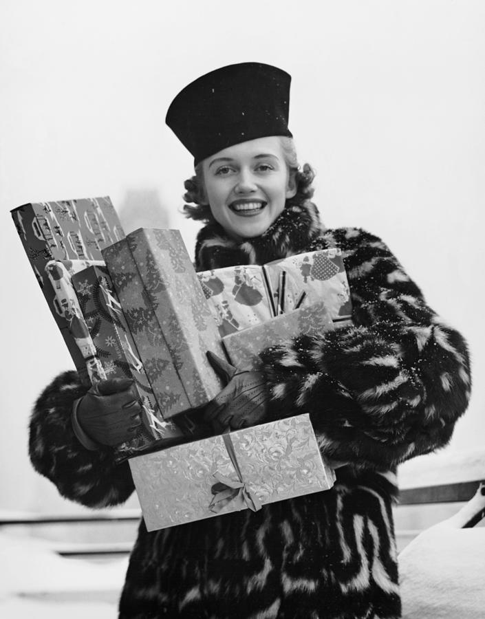 Woman In Fur Coat Holding Christmas Photograph by George Marks