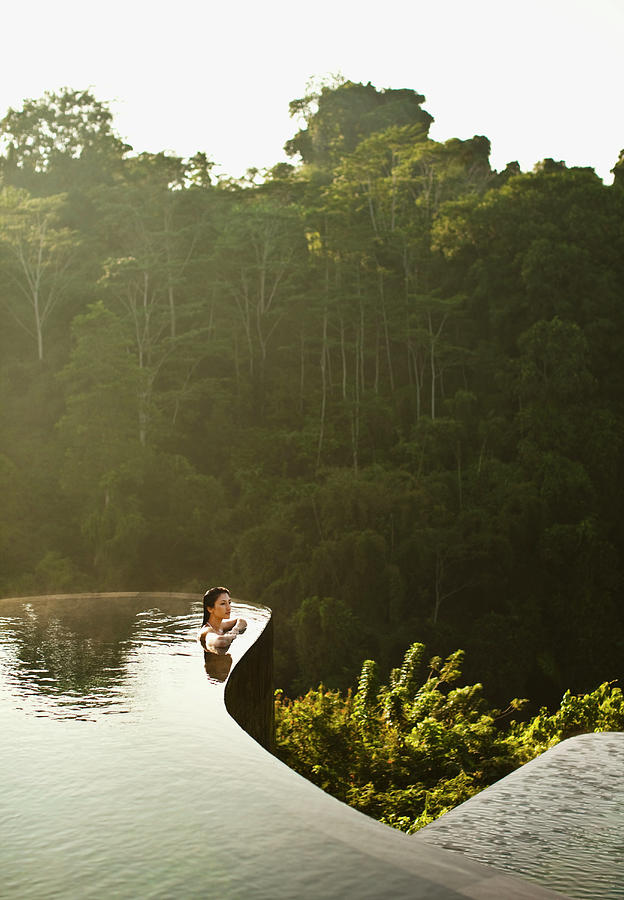Woman In Infinity Pool At Sunrise. Bali Photograph by Matthew  Wakem