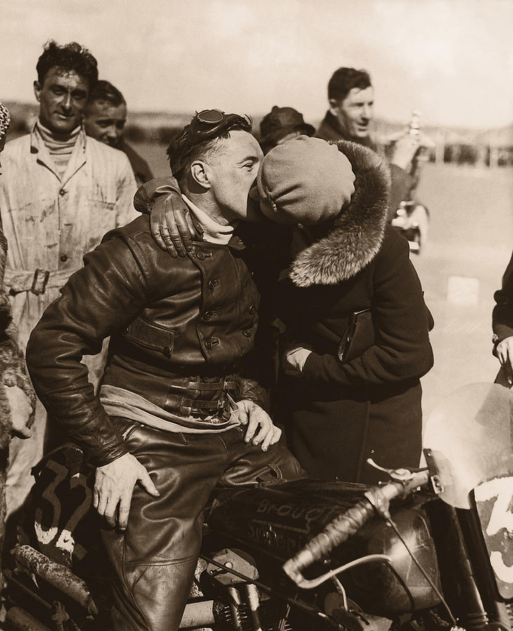 Woman Kissing Motorcycle Racer B&w Photograph by Fpg