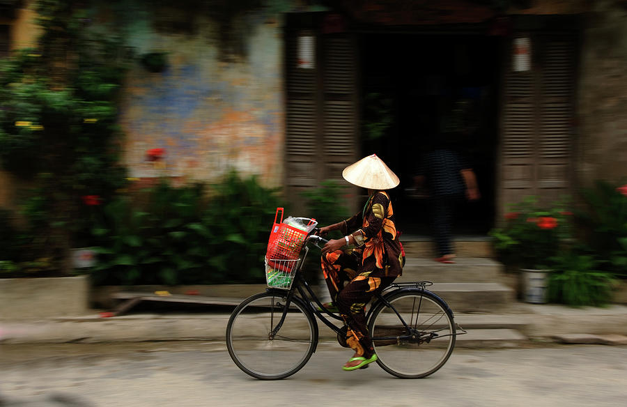 Woman On Bicycle, Hoi An, Vietnam Photograph by Jeremy Horner