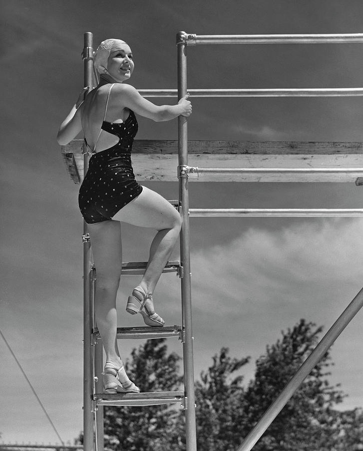 Woman On Diving Board Photograph by George Marks