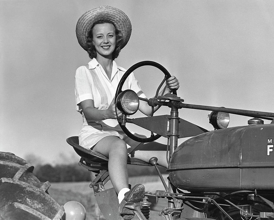 Woman On Tractor Photograph by George Marks