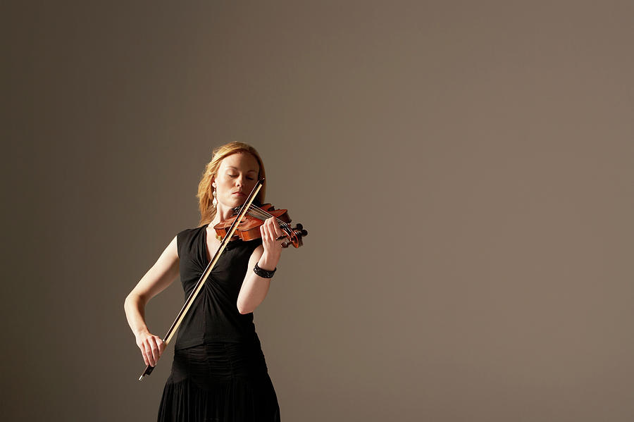 Woman Playing Violin Photograph by Moodboard