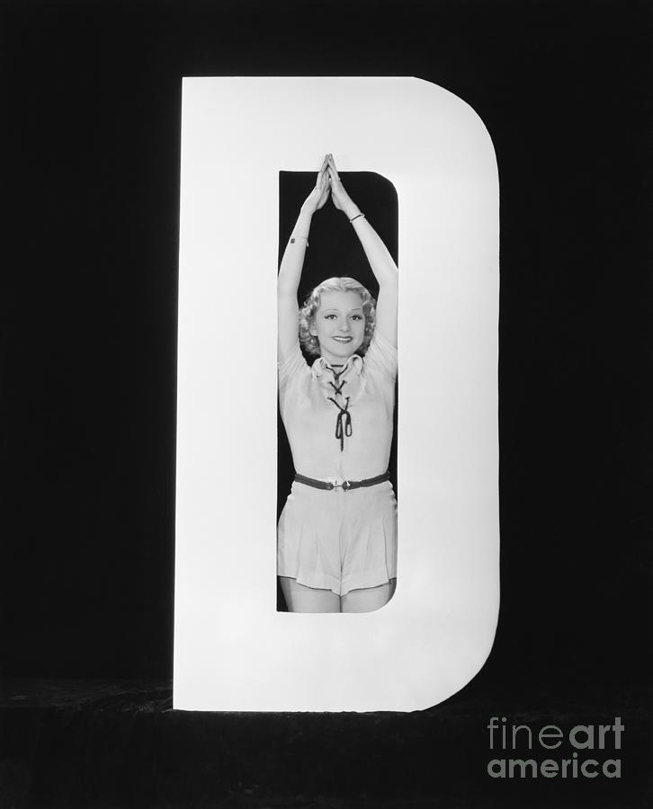 Behind Photograph - Woman Posing In Middle Of Letter D by Everett Collection