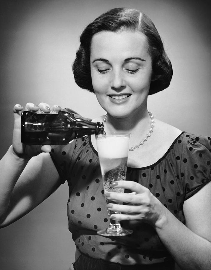 Woman Pouring Alcoholic Beverage Photograph by George Marks