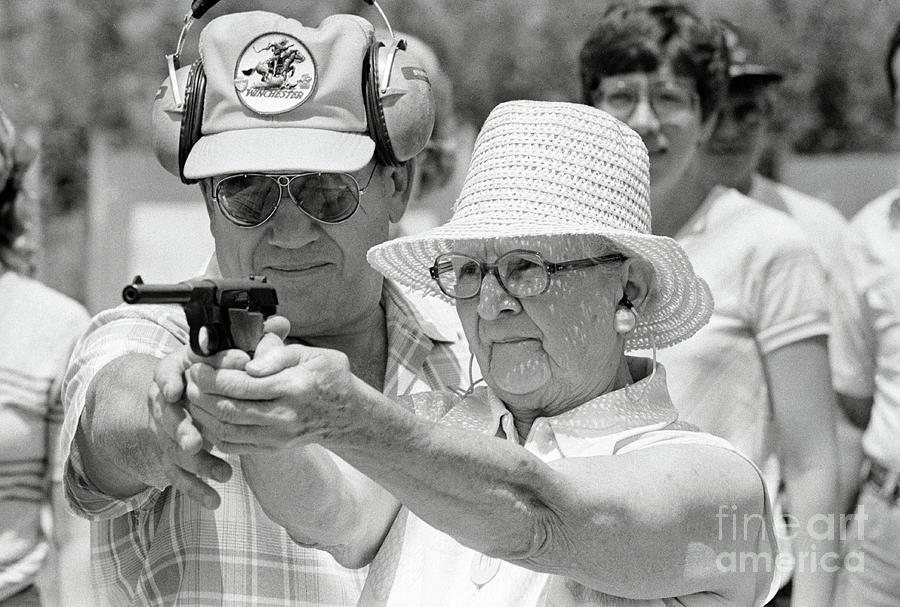 Woman Practicing Firing A Gun Photograph by Bettmann