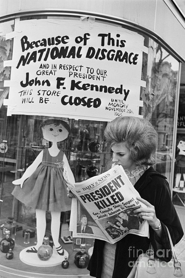 Woman Reading About President Kennedys Photograph by Bettmann