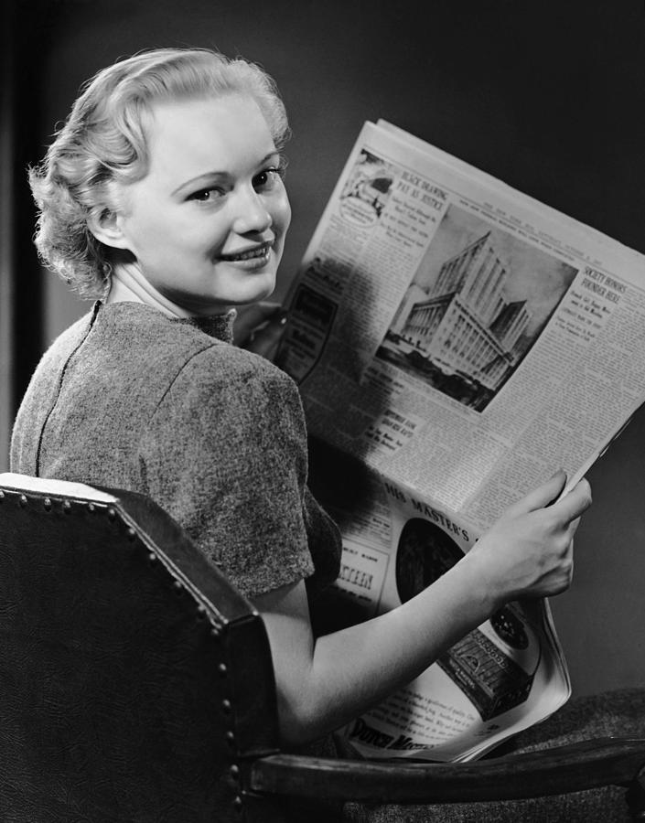 Woman Reading Newspaper Photograph by George Marks