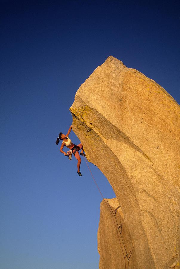 Woman Rock Climber Climbing Cliff Wall Photograph by Greg Epperson